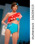 Small photo of CANARY ISLANDS -JUNE 22: An unidentified model walks the runway in the Calima collection during Gran Canaria Moda Calida swimwear fashion show on June 22, 2012 in Canary Islands, Spain