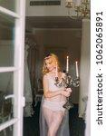 sexy blonde bride in white... | Shutterstock . vector #1062065891