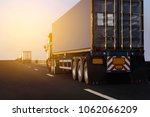 truck on highway road with big ... | Shutterstock . vector #1062066209