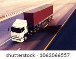white truck on highway road... | Shutterstock . vector #1062066557