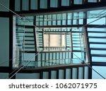 Small photo of Upward Staircase. Upward Stairway. Made of glass. Daylight.