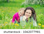 mother and daughter lying on... | Shutterstock . vector #1062077981