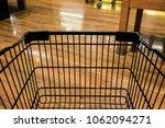 black shopping cart in... | Shutterstock . vector #1062094271