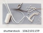Small photo of Dress making jewels and tools. Clothing alteration shop.
