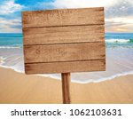 wood sign on beach background   Shutterstock . vector #1062103631