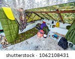 simple campground in the winter ... | Shutterstock . vector #1062108431