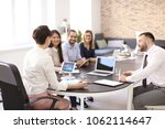 office employees having meeting ... | Shutterstock . vector #1062114647