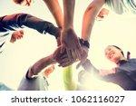 diverse people joined hands... | Shutterstock . vector #1062116027
