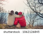gay male couple sitting on... | Shutterstock . vector #1062126845