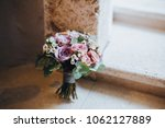 bouquet of flowers and greens... | Shutterstock . vector #1062127889