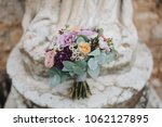 bouquet of flowers and greens... | Shutterstock . vector #1062127895