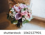 bouquet of flowers and greens... | Shutterstock . vector #1062127901