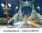 budapest at night. tram on old... | Shutterstock . vector #1062128954
