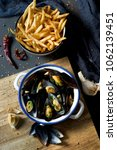 moules frites  mussels and...   Shutterstock . vector #1062139451