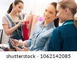 three girls at garment factory. ... | Shutterstock . vector #1062142085