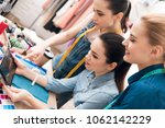 three girls at garment factory. ... | Shutterstock . vector #1062142229