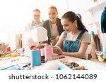 three women at garment factory. ... | Shutterstock . vector #1062144089