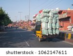 Small photo of Leh,India - May 07 2016 : truck with overload goods on road in Leh town,India.
