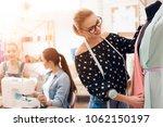 three women at garment factory. ...   Shutterstock . vector #1062150197