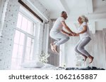Stock photo love lives forever senior couple at home handsome old man and attractive old woman are enjoying 1062165887