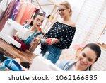 three girls at garment factory. ... | Shutterstock . vector #1062166835
