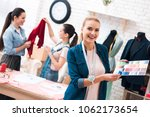 three girls at garment factory. ... | Shutterstock . vector #1062173654