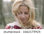 blonde woman portrait outdoor.... | Shutterstock . vector #1062175925