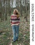 happy woman in forest | Shutterstock . vector #1062178505