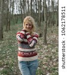 happy woman in forest | Shutterstock . vector #1062178511