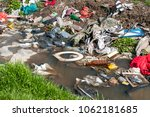 big pile of garbage and junk in ... | Shutterstock . vector #1062181685