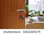 half opened door into the cozy...   Shutterstock . vector #1062204275