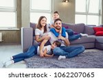 happy family smiling sitting at ...   Shutterstock . vector #1062207065