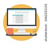 desktop computer with coffee... | Shutterstock .eps vector #1062231131