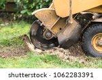 stump grinder in action | Shutterstock . vector #1062283391