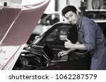 mechanic checking and fix car... | Shutterstock . vector #1062287579