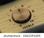 Small photo of Close-up shot of a retro-style wireless speaker treble dial.