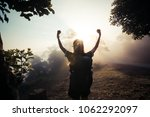 Small photo of Happy young Girl Enjoy Backpacking.Watch the first light of the morning sun on the mountain.Feel refreshed and energize your life.