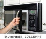 opening a microwave door | Shutterstock . vector #106230449