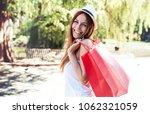 woman in shopping. happy woman... | Shutterstock . vector #1062321059