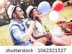 picnic time. young smiling... | Shutterstock . vector #1062321527
