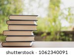 book on wooden table on bright... | Shutterstock . vector #1062340091