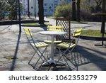 yellow bistro chairs or garden... | Shutterstock . vector #1062353279