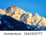 Small photo of Beautiful peaks of Himalayas in Manali Valley, India during Sunrise.