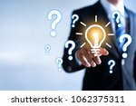 businessman touching a light... | Shutterstock . vector #1062375311