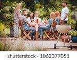 grill in the garden. friends... | Shutterstock . vector #1062377051