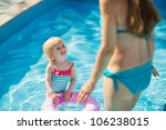 baby standing in pool with... | Shutterstock . vector #106238015