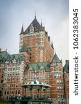 Small photo of Quebec City, Quebec, Canada, June 28, 2017: People walk along the boardwalk next to the Chateau Frontenac in Old Quebec City