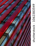 Small photo of Modern architecture. Fragment facade of a commercial building with offices. named of Red Apple Building in Rotterdam, Netherlands.