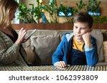 sad caucasian boy is feeling...   Shutterstock . vector #1062393809