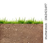 green grass on the soil at... | Shutterstock . vector #1062421697
